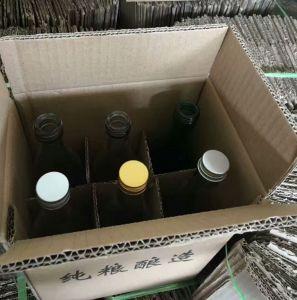 卸し売りデザイン円形のガラスワインかアルコール飲料のびん