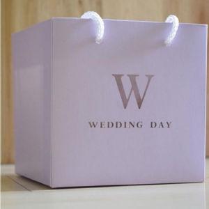 カスタムプリント上塗を施してある結婚式のペーパーギフト袋