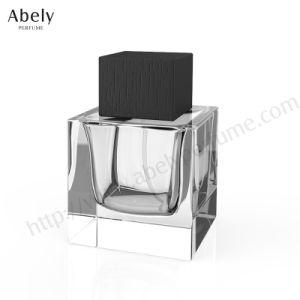 ポンプおよび帽子が付いている熱い販売法100mlの香水のガラスビン