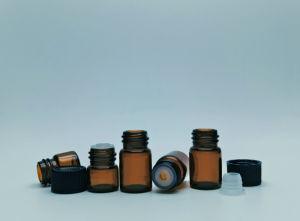 Botella de aceite esencial de vidrio con resinas fenólicas pac y reductores de orificio
