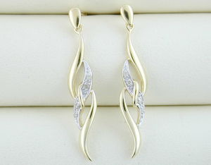 orecchino dell'oro giallo 10K con il diamante