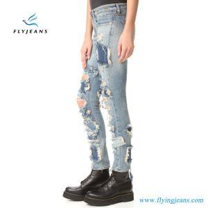 Zone sfilacciate e jeans tagliuzzati del denim delle donne dei fori (P.E. 332 dei pantaloni)
