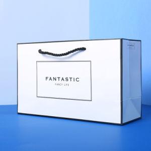 Libro blanco de la bolsa de compras para el envasado de regalo, en el bolso, una pequeña bolsa de regalo fresca, ropa, bolsas de embalaje, ir de compras bolsa de papel, personalizar