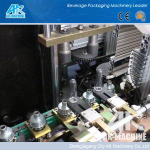 Haute vitesse automatique Servo-Driven 200ml~2L'eau minérale en plastique Prix Pet Bouteille de vin de jus de faire souffler le moulage par soufflage de la machine de moulage
