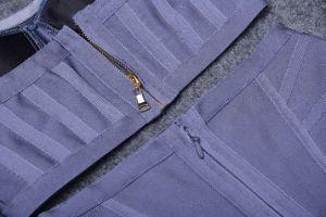 黒いストラップレスの包帯の二つの部分から成ったスーツのカクテルクラブ服