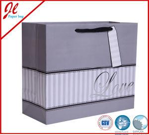Sacchi di carta scintillanti d'argento del regalo di cerimonia nuziale di amore con la modifica di caduta