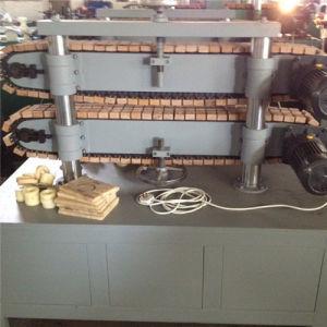 آليّة يغضّن خرطوم يشكّل آلة