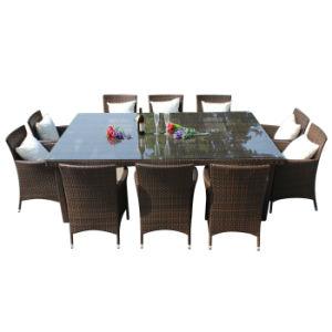 En el exterior patio jardín mobiliario de mimbre Rattan Silla de Comedor mesa con vidrio
