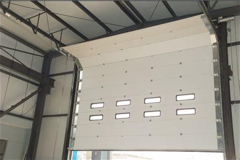 China Heavy Duty Industiral Sectional Garage Door With Swing Door